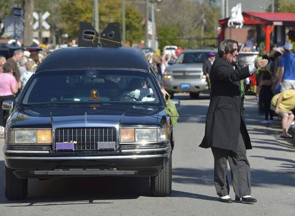 Dr. Paul Bearer walking a parade route